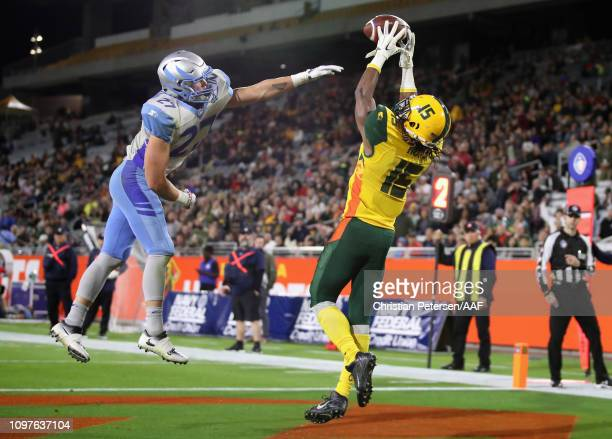 Da'SeanDowney of the Arizona Hotshots catches a touchdown pass over MicahHannemann of the Salt Lake Stallions during the second half of the...