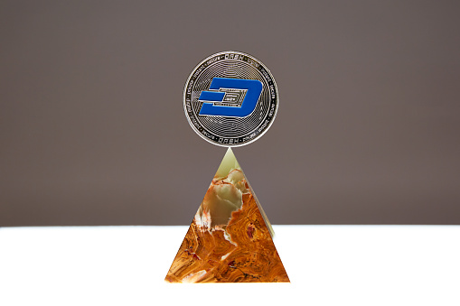 Dash Coin floating above an Onyx Stone Pyramid - gettyimageskorea
