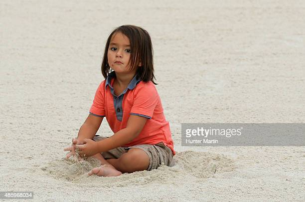 Dash Day plays in a bunker after his father Jason Day of Australia won the event with a sixstroke victory at The Barclays at Plainfield Country Club...