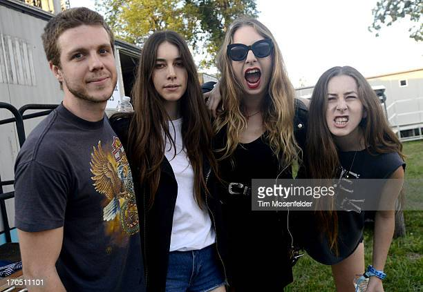 Dash Hutton Danielle Haim Este Haim and Alana Haim of HAIM pose at Day 1 of the Bonnaroo Music And Arts Festival on June 13 2013 in Manchester...