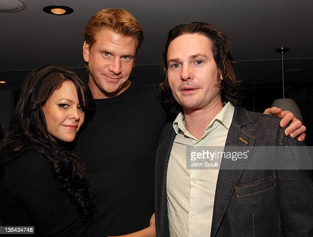 Dash Mihok Henry Thomas and guest during Armani Exchange Details Magazine 'Insider' Party at AREA in Los Angeles California United States