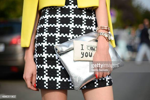 Dasha Gold poses wearing a Sheike jacket Shakuhachi dress and French Connection bag on September 24 2014 in Paris France