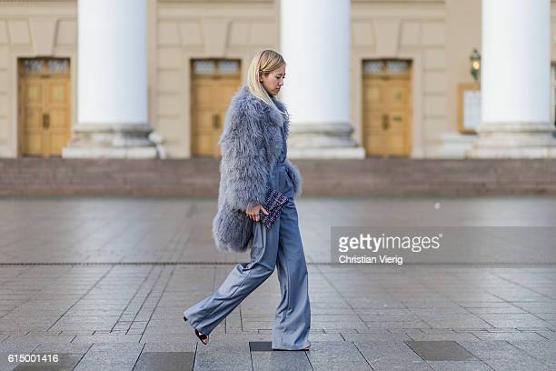 Dasha Li wearing a fur coat from Hong Kong selfmade handmade trosuers and top on October 15 2016 in Moscow Russia