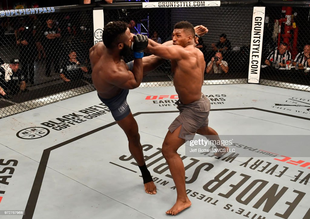 Dashawn Boatwright kicks Alonzo Menifield in their light heavyweight bout during Dana White's Tuesday Night Contender Series at the TUF Gym on June 12, 2018 in Las Vegas, Nevada.