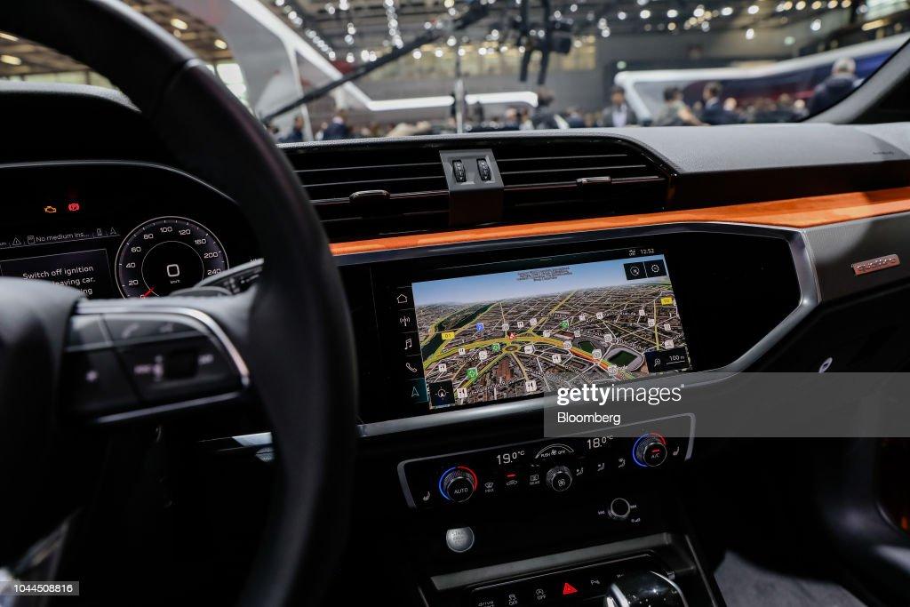 A dashboard monitor displays a map inside an Audi AG e-Tron