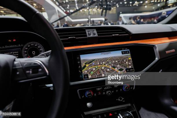 A dashboard monitor displays a map inside an Audi AG eTron 55 Quatro electric automobile during the Paris Motor Show in Paris France on Tuesday Oct 2...