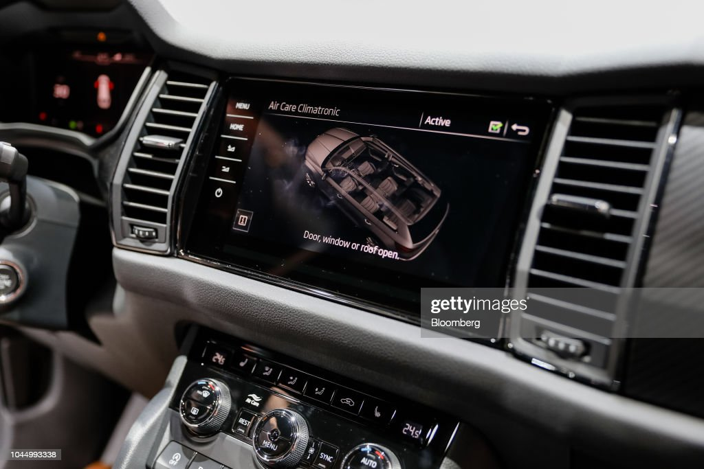 A dashboard monitor displays vehicle information inside a Skoda