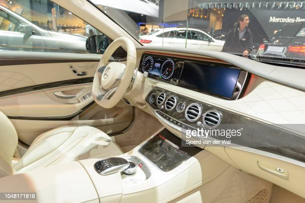 Dashboard on a Mercedes-Benz S500e Plug-in Hybrid luxury limousine sedan fitted with light leather seats, wood trim and a large information display...
