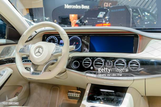 Dashboard on a MercedesBenz S500e Plugin Hybrid luxury limousine sedan The vehicle is fitted with light leather seats wood trim and a large...
