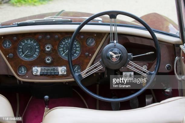Dashboard temperature gauge rev counter speedometer speedo car radio and steering wheel of Alvis TD21 DHC classic car