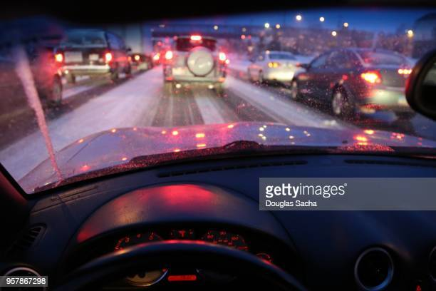 dashboard view of a moving car in a snow storm - dashboard camera point of view stock photos and pictures