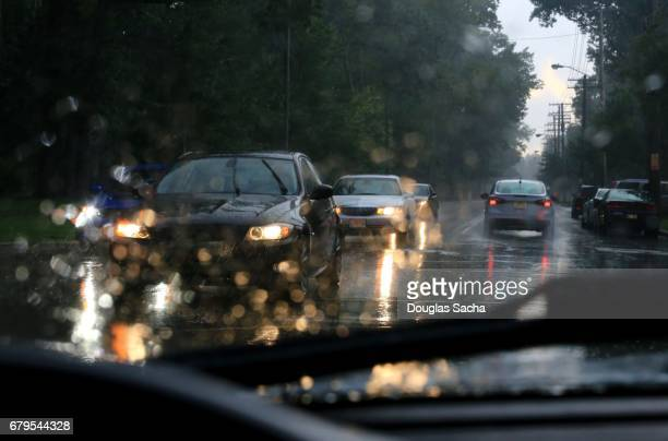 dashboard view of a moving car on a rainy night - dashboard camera point of view stock photos and pictures