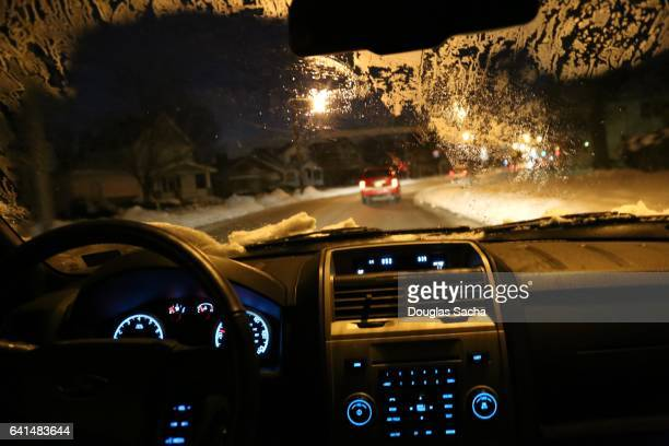 Dashboard view of a moving car on a winter night