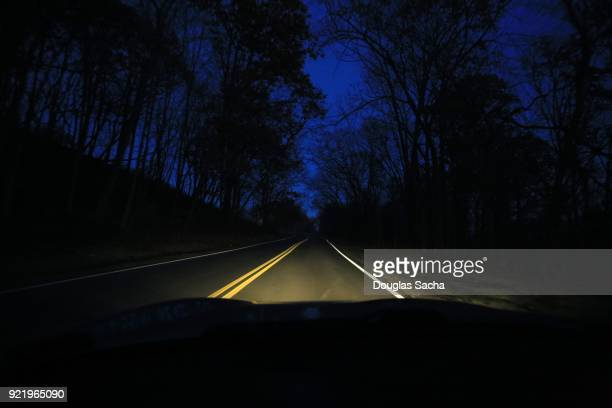 Dashboard view of a moving car on spooky night