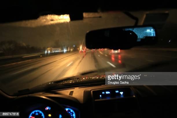 Dashboard view of a vehicle on a rainy night