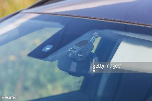dashcam behind the front window of a car - dashboard camera point of view stock photos and pictures