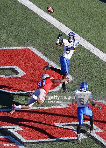 Dasheon Frierson of the San Jose State Spartans tries to intercept a pass in the end zone intended for Devante Davis of the UNLV Rebels as Damon...