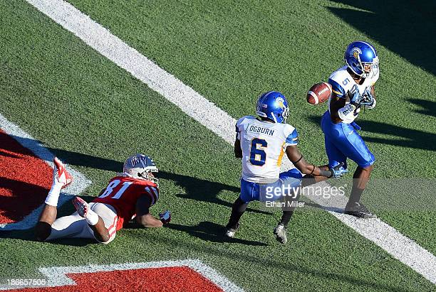 Dasheon Frierson of the San Jose State Spartans tries to tip a pass in the end zone intended for Devante Davis of the UNLV Rebels to Damon Ogburn Jr...