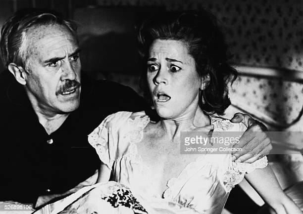Dashiell Hammett comforts Lillian Hellman when she wakes from a nightmare in the 1977 film Julia
