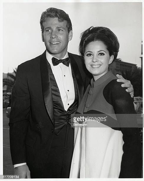 Dashing Ryan O'Neal is being divorced by beauteous wife Joanna Moore and who is comforting him in his marriage doldrums Beauteous Barbara Perkins...