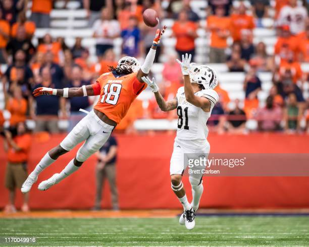 DaShon Bussell of the Western Michigan Broncos makes a first down reception despite coverage by Scoop Bradshaw of the Syracuse Orange during the...