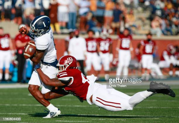 Da'Shon Ross of the University of Massachusetts Minuteman forces a fumble from Shai Werts of the Georgia Southern Eagles on October 17, 2020 at Allen...