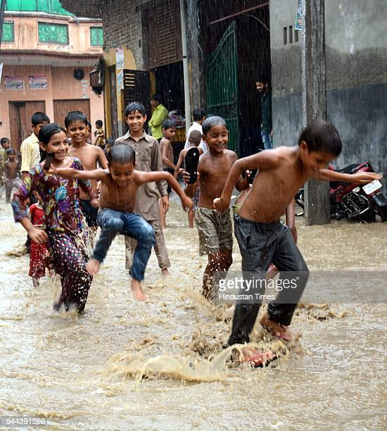 Dasna Children enjoy premonsoon rain showers during the weekend on July 3 2016 in Ghaziabad India The maximum temperature was recorded at 302 degrees...