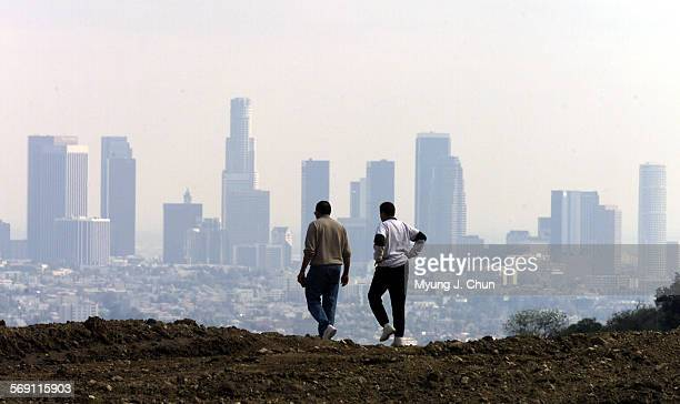 Dasol 56 and wife Paulette Mashaka of Carson enjoy the view of the Los Angeles skyline from an empty lot off Mulholland Drive in Studio City on...