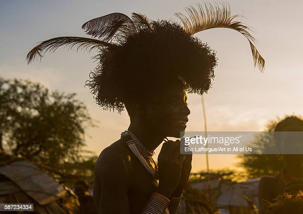 Dassanech man dressing with a ostrich feathers headwear for dimi ceremony to celebrate circumcision of the teenagers omo valley omorate Ethiopia on...