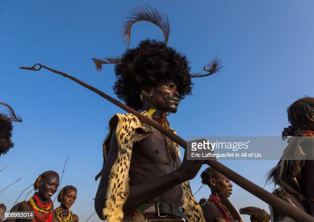 Dassanech men with leopard skins and ostrich feathers wigs during Dimi ceremony to celebrate circumcision of teenagers Turkana County Omorate...