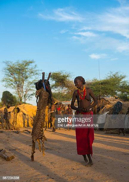 Dassanech tribe woman dressing for the dimi ceremony to celebrate the circumcision of the teenagers omo valley omorate Ethiopia on March 20 2016 in...