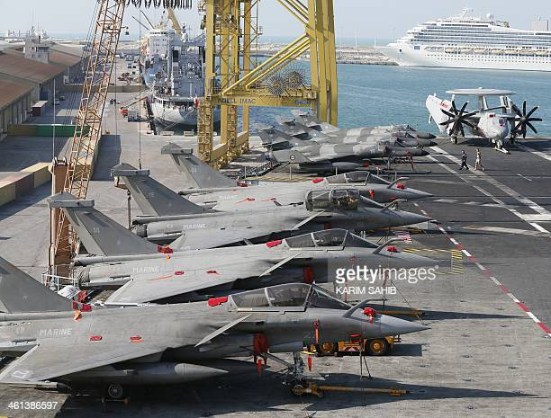Dassault Aviation French made Rafales and SuperEtendards belonging to the French navy are parked on the flight deck of the French aircraft carrier...