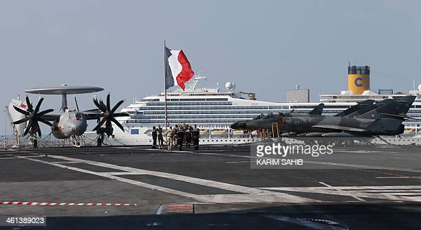 Dassault Aviation French made SuperEtendards and a Hawkeye airplane belonging to the French navy are parked on the flight deck of the French aircraft...
