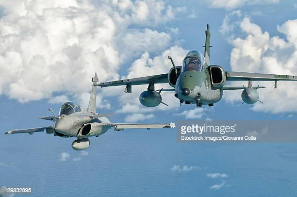 a dassault rafale of the french air force flys alongside an embraer a-1b of the brazilian air force during cruzeiro do sul (cruzex) in brazil.  - dassault rafale stock pictures, royalty-free photos & images