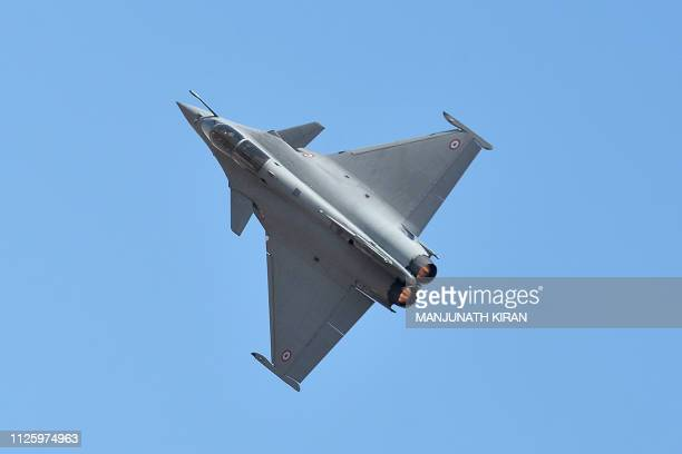 A Dassault's Rafale fighter jet performs a manoeuvre during a flying display on the inaugural day of the fiveday Aero India 2019 airshow at the...
