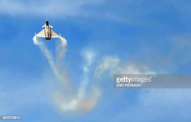 Dassault's Rafale performs its flying display on June 17, 2009 during the 48th international Paris Air Show at Le Bourget airport. The Paris Air...