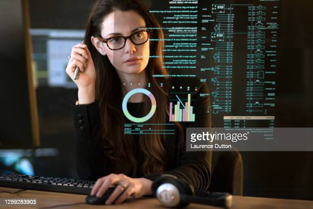 data dark office woman - science stock pictures, royalty-free photos & images