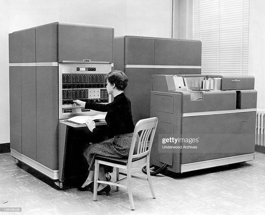 Data Processing System, the first mass produced computer, New York, 1954. IBM sold 450 of them the first year. Acessories include up to 4 disk units, each holding 6 Mb of data.