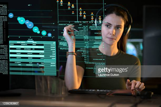 data screen woman - scientific experiment stock pictures, royalty-free photos & images