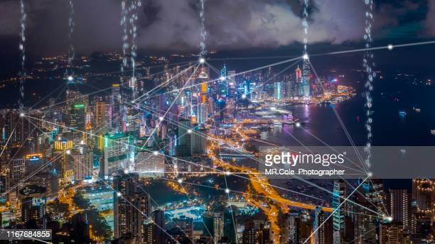 data transfer over hong kong city,connection and  wireless network technology.smart city,internet of things,big data,fin tech concept - big tech stock pictures, royalty-free photos & images
