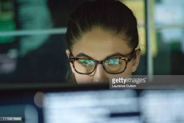 data woman monitors - analysing stock pictures, royalty-free photos & images