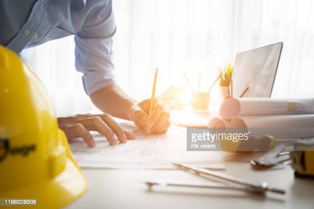 data working and tablet laptop - building contractor stock pictures, royalty-free photos & images