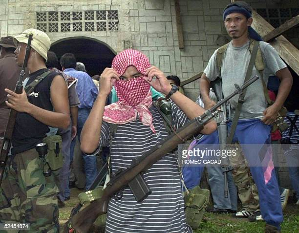 Dated 27 May 2000 file picture shows AlQaeda linked Abu Sayyaf gunmen guard a mosque in Bandang village Jolo island where their leaders and group of...