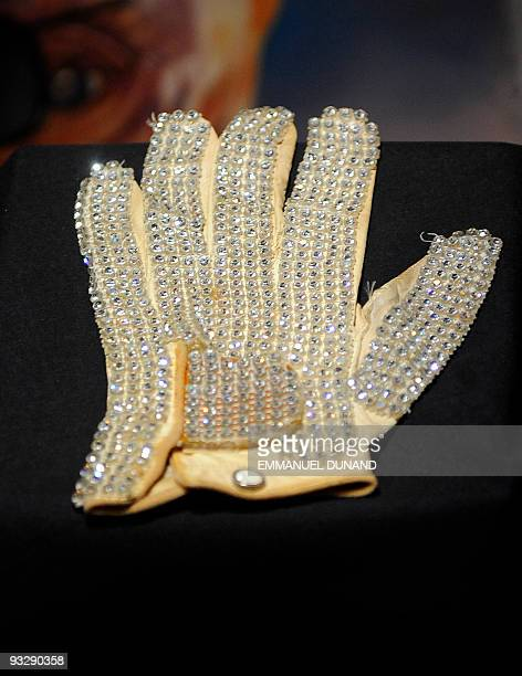 Dated November 17 2009 filed photo shows Michael Jackson's white jewel glove is on display at an auction preview in New York The rhinestoneencrusted...