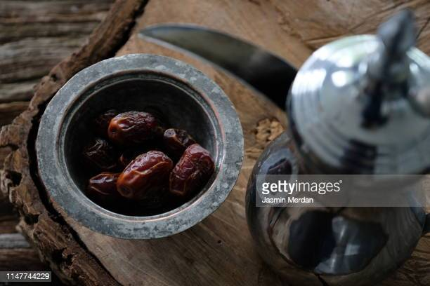 date-fruit and arabian coffee - fasting activity stock pictures, royalty-free photos & images