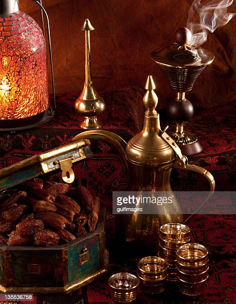 Dates and tea set with Ramadan ornaments