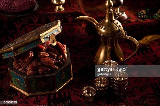 Dates and tea set with Ramadan ornaments