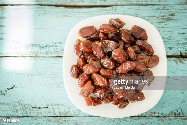 dates on pastel green wooden table - written date stock pictures, royalty-free photos & images