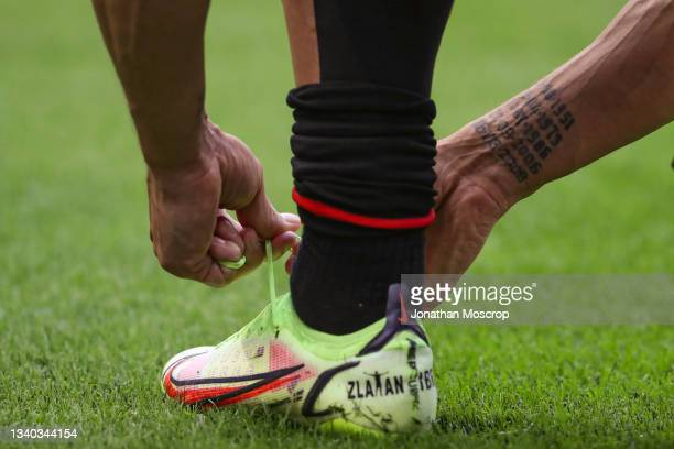 Dates tattooed on the wrist of Zlatan Ibrahimovic are seen as he laces his personalised Nike Mercurial football boots during the warm up prior to the...