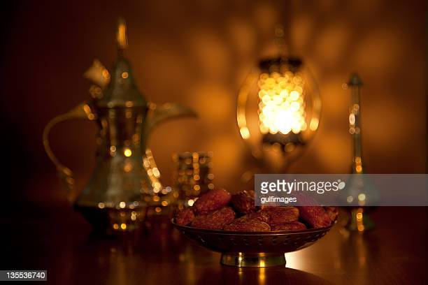 Dates with tea set, rosewater sprinkler and illuminated lantern